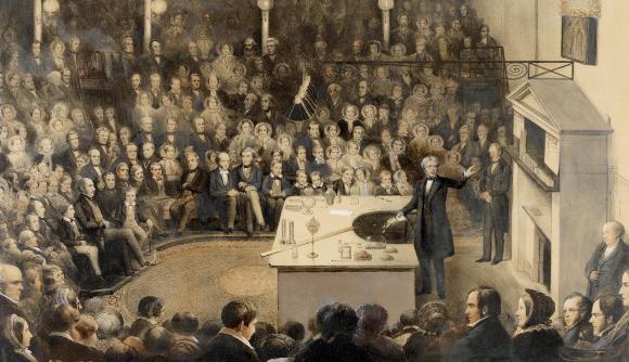 פאראדיי בהרצאת חג מולד לקהל הרחב במכון המלכותי, 1855   מקור: ROYAL INSTITUTION OF GREAT BRITAIN / SCIENCE PHOTO LIBRARY