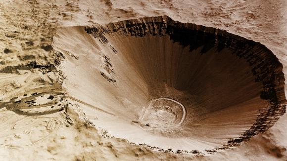 מכתש סדאן בקוטר כ-400 מטר שנוצר בפיצוץ גרעיני יזום בנבאדה | צילום: OMIKRON / SCIENCE PHOTO LIBRARY