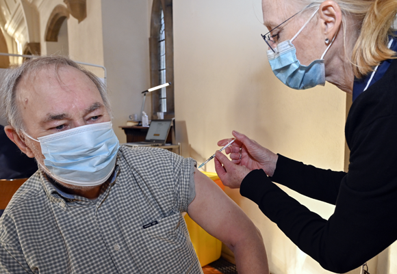 Picture of a man injected with a vaccine | Dr P. Marazzi / Science Photo Library