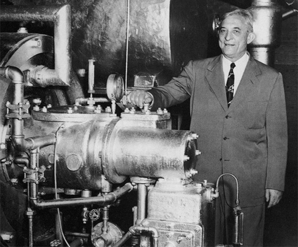 Willis Carrier next to an air conditioning system | Source: SCIENCE SOURCE / SCIENCE PHOTO LIBRARY