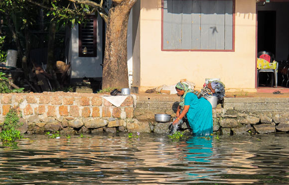A woman doing laundry in the river in India, 2015 | Photography: Just Another Photographer, Shutterstock