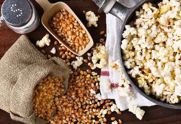 Start with popcorn. Corn kernels and popcorn | Photo: Steve Cukrov, Shutterstock