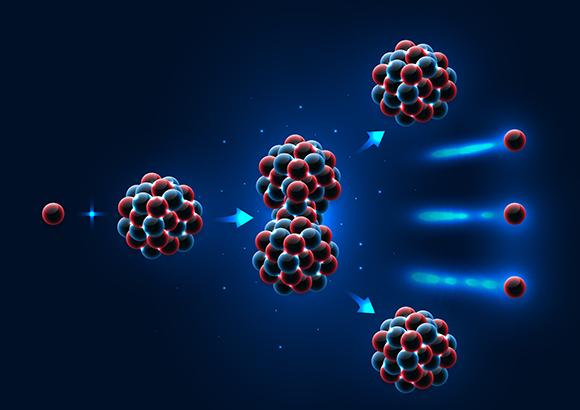 הנייטרון (כדור אדום) פוגע בגרעין האורניום וזה מתפרק לשניים, ופולט שלושה נייטרונים   Shutterstock, adison pangchai